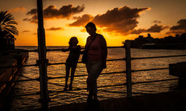 Mum and daughter by railings Royalty Free Stock Image