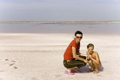 Mum and daughter on salty lake Stock Image