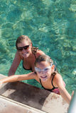 Mum and daughter in the sea Stock Images
