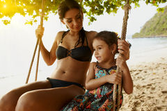 Girl with mum on swing Royalty Free Stock Photo