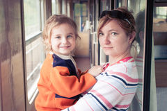 Mum and daughter. Traveling by train Stock Photo
