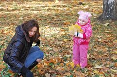 Mum with a daughter walk in autumn Stock Images
