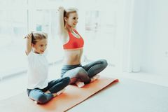 Mum And Daughter Yoga Training. Lotus Position. stock photography