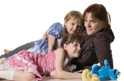 Mum and daughters lie on floor Royalty Free Stock Image