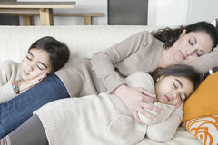Mum and daughters sleeping on couch Royalty Free Stock Image