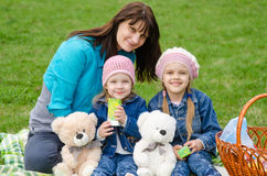 Mum embraces daughters on a picnic Royalty Free Stock Photos