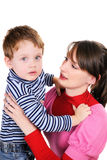Mum embraces the small son Stock Photos