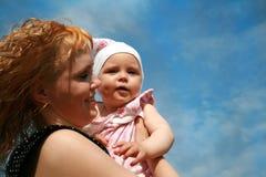 Mum en jong geitje Royalty-vrije Stock Afbeeldingen