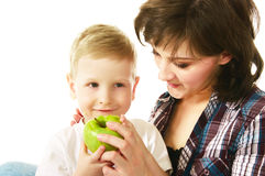 Mum feeding her son. With green apple Stock Images