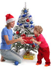 Mum gives a gift to the daughter for Christmas 2 Royalty Free Stock Photo