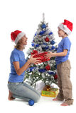 Mum gives a gift to the son for Christmas. Mum gives gift to the son for Christmas Royalty Free Stock Photo