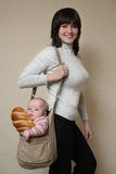 Mum has come from shop!. Mum with the son and a long loaf in a bag Royalty Free Stock Images