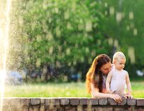 Mum and her Child playing in Park Stock Photos