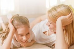 Mum and her cute daughter child girl are playing, smiling and hugging. Happy mother& x27;s day. Family holiday and togetherness stock images