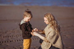The mum is holding her son's hands Stock Photo