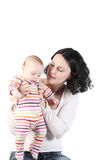 Mum holds on hands of the baby. Stock Photo