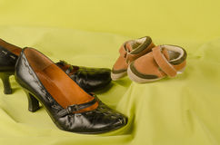 Mum and kid shoes. Mom and kid shoes together in a still life Stock Image