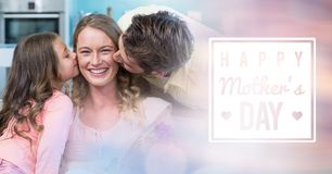 Mum kissed by her husband and her daughter for mother`s day Stock Images