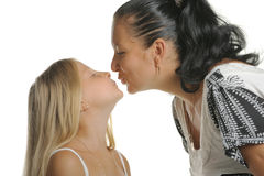 Mum kisses the daughter Stock Photo