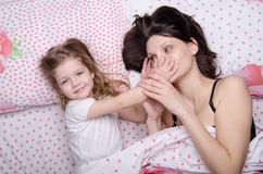 Mum kisses the hand of his daughter royalty free stock images
