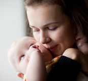 Mum kisses small son. Mum kisses the small son Royalty Free Stock Photos