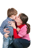 Mum kisses the small son Royalty Free Stock Photos