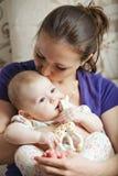 Mum kissing baby head Royalty Free Stock Photography