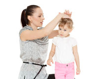 Mum looks after hair of the child. Stock Image