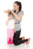 Mum looks after hair of the child. Stock Images