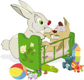 Mum and not an obedient small rabbit. Rabbit mum swinging a rabbit in a cradle Royalty Free Stock Photo