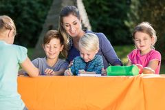 Mum painting pictures with their children and during lunch break Royalty Free Stock Images