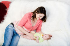 Mum plays with little  baby Stock Photo
