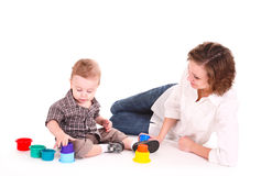 Mum plays with the small son. Stock Photo