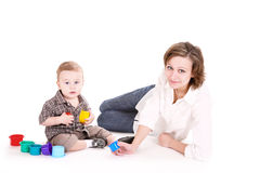Mum plays with the small son. Stock Photos