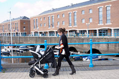 Mum pushing a pram Stock Photography
