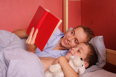 Mum puts to bed a sonny. 8 royalty free stock photo
