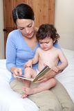 Mum reading to ill baby Royalty Free Stock Images