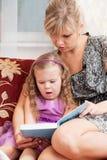 Mum reads the book Stock Photo