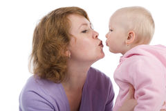 Mum with a small daughter. Gentle kiss. Mother kisses the daughter Royalty Free Stock Images