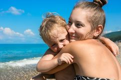 Mum with small son on beach Stock Photo