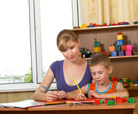 Mum with son. The mum with son is engaged in a children's room Royalty Free Stock Photos