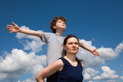 Mum and son. Against blue sky royalty free stock image