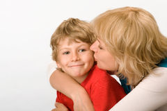 Mum and the son. Mum gently kisses the son Stock Photos