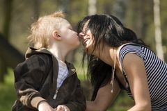 Mum with the son. Small boy kisses his mum Royalty Free Stock Images