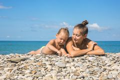Mum with son on beach Royalty Free Stock Photo