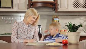 Mum and the son at breakfast Royalty Free Stock Photo