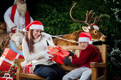 Mum and son disputing of santa claus's gifts Royalty Free Stock Photography