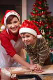 Mum and son having fun at christmas baking Stock Photos