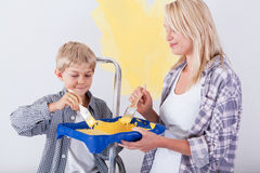 Mum and son painting wall Royalty Free Stock Images