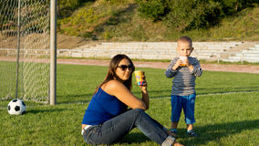Mum and son playing soccer Royalty Free Stock Image